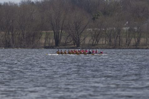 Iowas varsity 8 crew passes Wisconsin the first session of a womens rowing meet on Lake MacBride on Saturday April 13, 2019. They won the race by 7.49 seconds Iowa won 3 out of 12 races with the varsity 8 crew winning both races for the day.