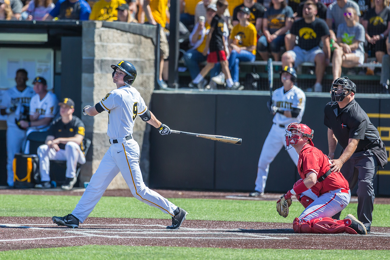 Iowa outfielder Ben Norman watches the ball after making contact during a baseball game between Iowa and Nebraska at Duane Banks Field on Saturday, April 20, 2019. The Hawkeyes defeated the Cornhuskers, 17-9.