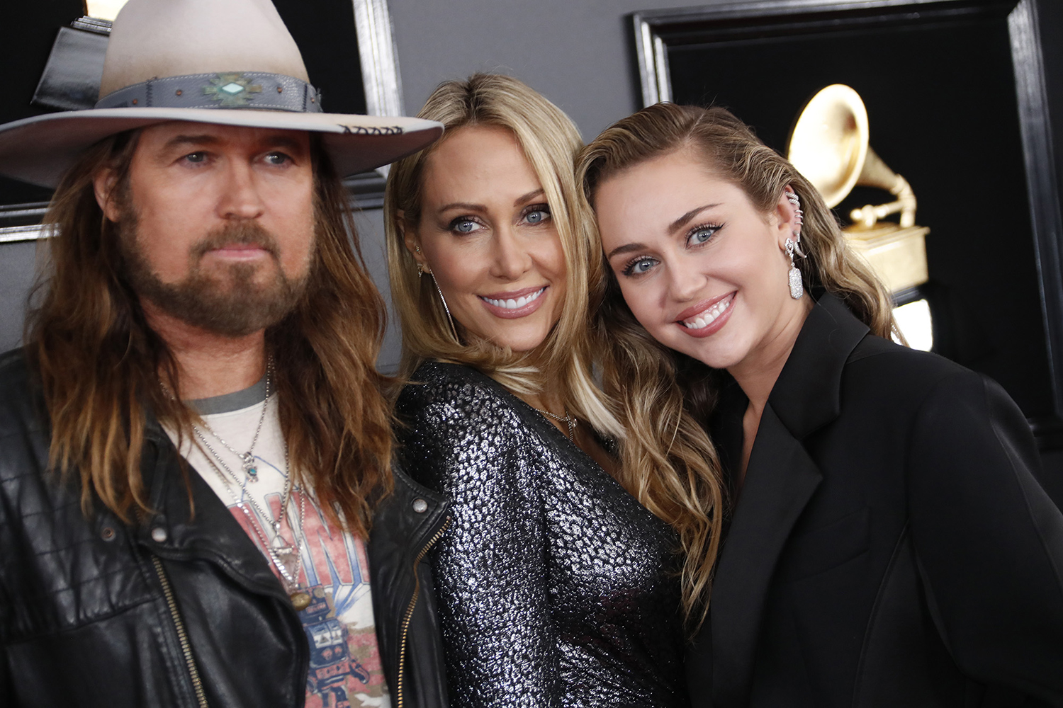 From left, Billy Ray Cyrus, Tish Cyrus, and Miley Cyrus arrive at the 61st Grammy Awards at Staples Center in Los Angeles on Sunday, Feb. 10, 2019. (Marcus Yam/Los Angeles Times/TNS)