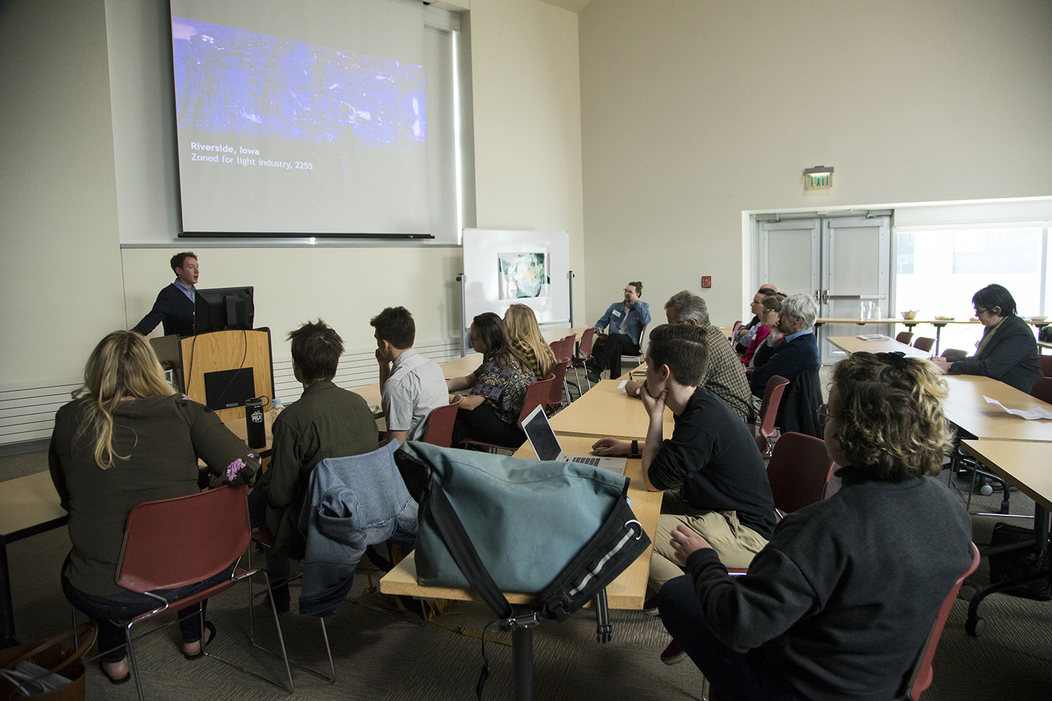 Students and judges listen to a presenter at an undergraduate presentation on City Planning for eight generations in the future in the advanced technologies building on April 24th, 2019. (Michael Guhin/The Daily Iowan)