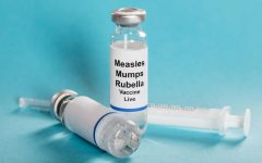Measles mumps rubella vaccine vials with syringe