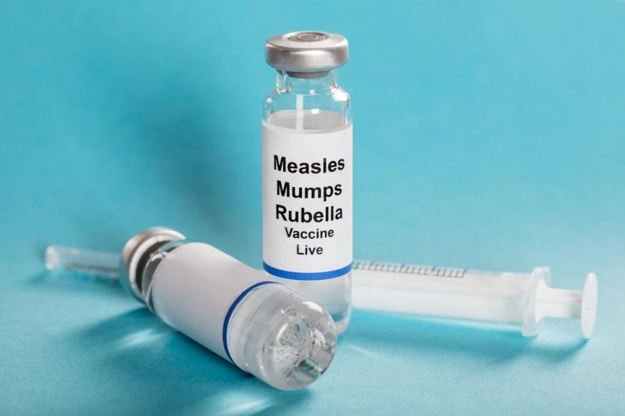 Measles+mumps+rubella+vaccine+vials+with+syringe