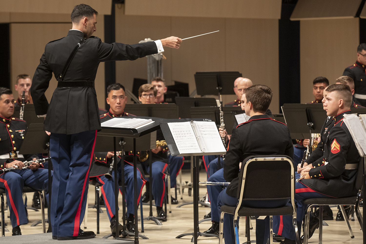 Warrant Officer Alex Panos conducts the band during the concert featuring the Marine Core Band concert at Voxman Music Building on Monday, April 15, 2019.