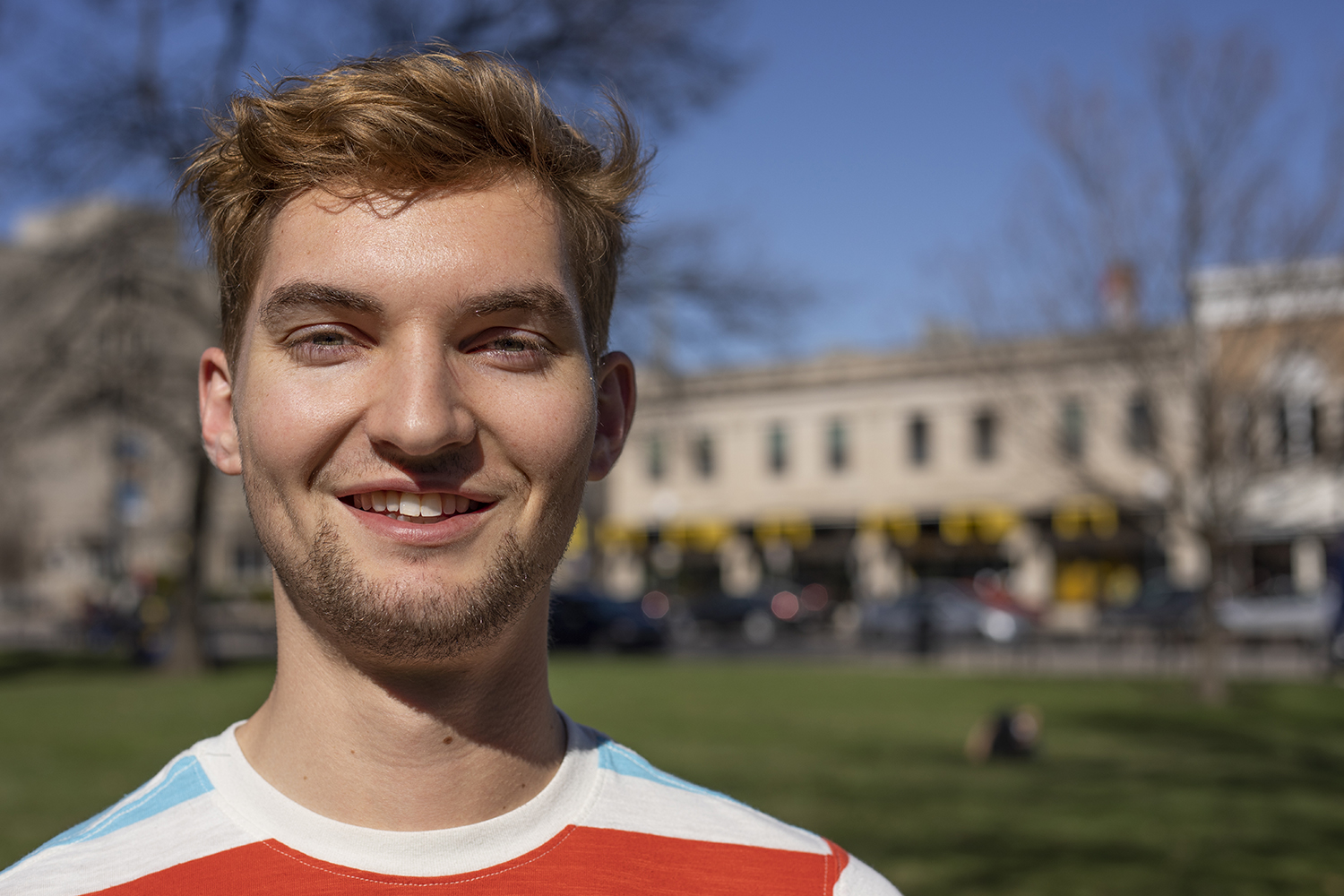 University of Iowa student Mark Schoen stands outside of Schaefer Hall for a portrait on Monday, April 8, 2019.