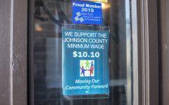 The minimum wage support sign can be seen at Shorts Burger & Shine on Monday, April 8, 2019.