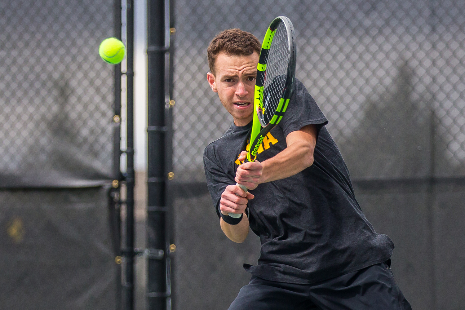 Iowa's Kareem Allaf hits a backhand during a men's tennis match between Iowa and Ohio State at the HTRC on Sunday, April 7, 2019. The Buckeyes defeated the Hawkeyes, 4-1.