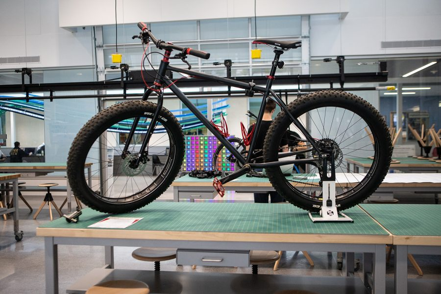 A hand made bike is seen during the Nexus Open House at the Seamans Center in Iowa City on Wednesday, April 24, 2019. During the event, students presented projects that combined art and engineering.