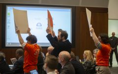 Faculty Forward cuts into regents' meeting to protest, call for sick-leave bank
