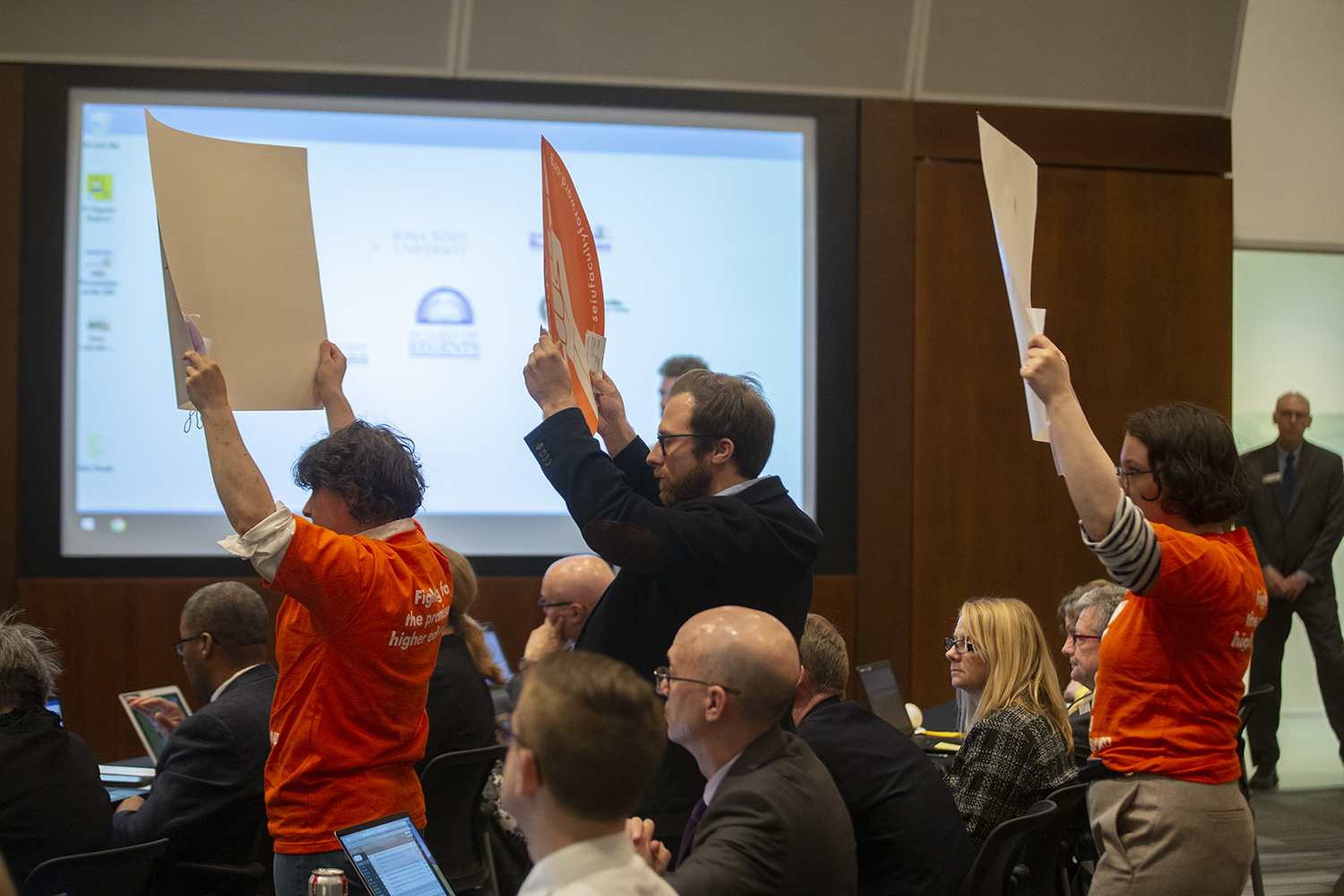 Faculty Forward members protest during the state Board of Regents meeting in the Levitt Center on Thursday, April 18, 2019.