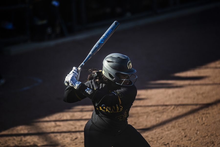 Iowa infielder Donirae Mayhew prepares to swing the bat during the game against Illinois at the Bob Pearl Softball Field on Saturday, April 13, 2019. The Hawkeyes defeated the Fighting Illini 4-3.