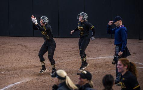 Late-game heroics boost Iowa softball over Illinois
