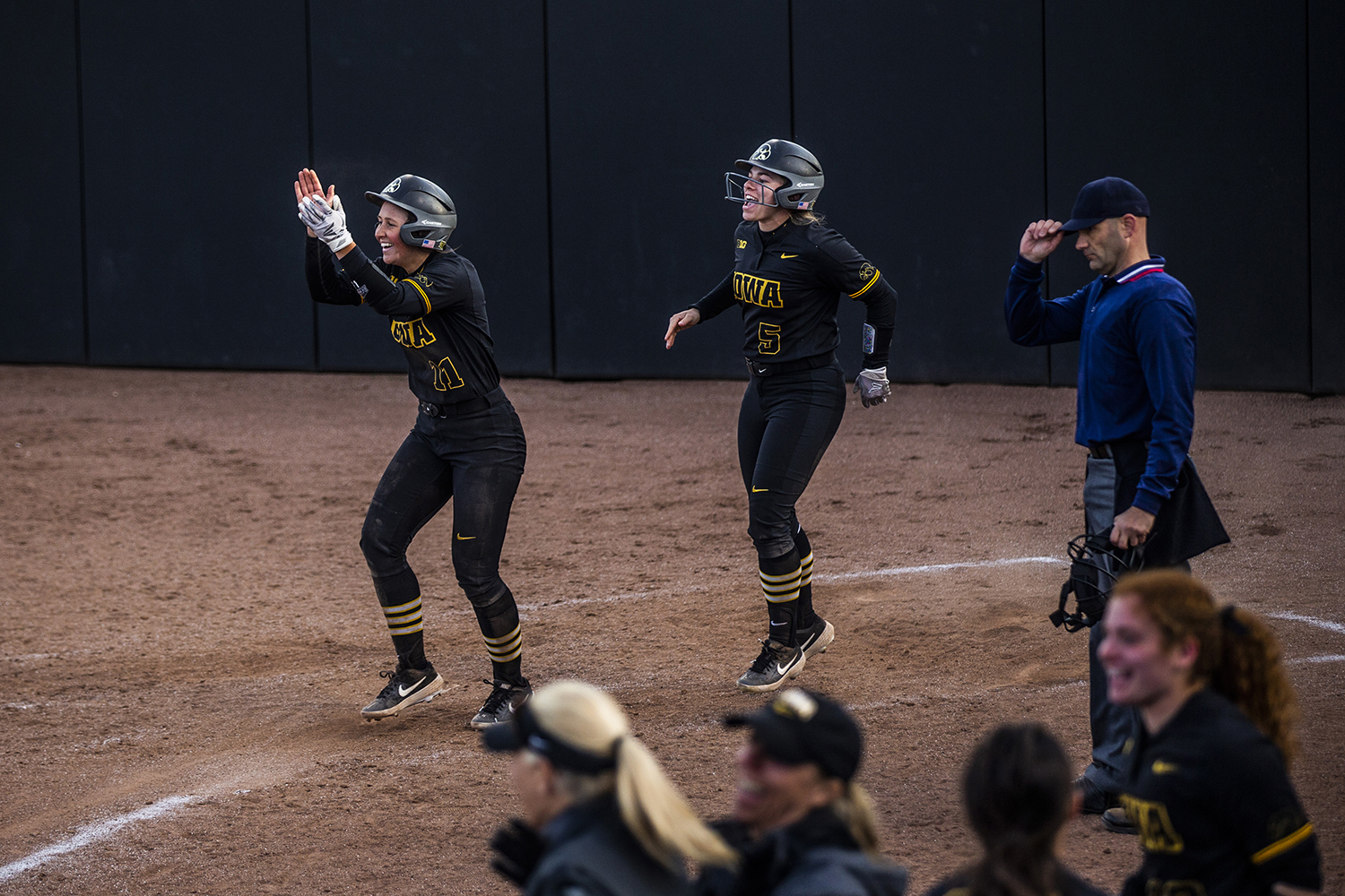 Iowa pitcher Mallory Kilian and infielder Sydney Owens cheer after Iowa scores the winning run during the game against Illinois at the Bob Pearl Softball Field on Saturday, April 13, 2019. The Hawkeyes defeated the Fighting Illini 4-3.