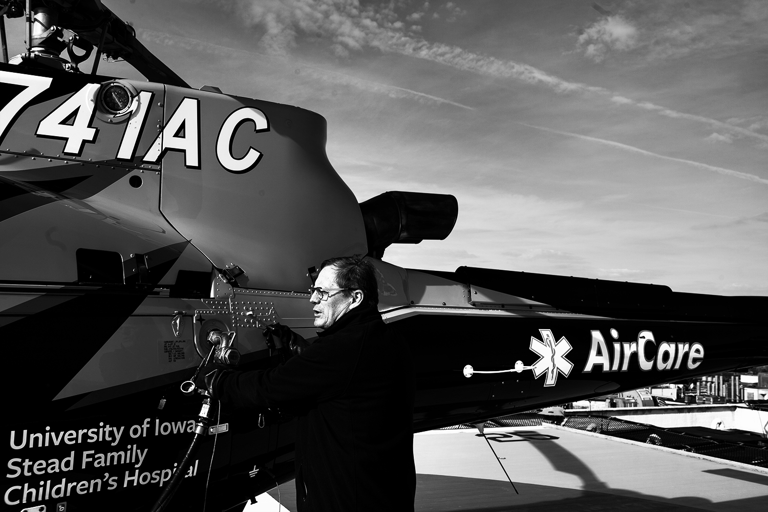 AirCare+lead+pilot+Tim+Whaylen+fuels+up+the+Aircare+helicoptor+after+a+flight+on+April+1%2C+2019+in+Iowa+City%2C+Iowa.+