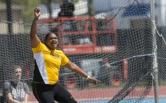 Iowa's Laulauga Tausaga watches her throw during the 18th annual Musco Twilight at Francis X. Cretzmeyer Track on Saturday, April 22, 2017. Iowa's men and women's track and field finished first overall in the Musco Twilight with a 237.5 and 203 respectively.
