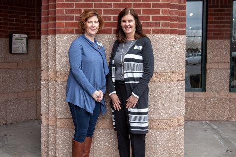 Trisha Smith (left,) and Katie Knight of United Way of Johnson and Washington Counties pose for a portrait outside of their Coralville office on Friday, March 29, 2019. The Johnson and Washington County United Way office, which is turning 100 this year, is planning a series of events aimed at garnering donations and spreading awareness for what the organization does.