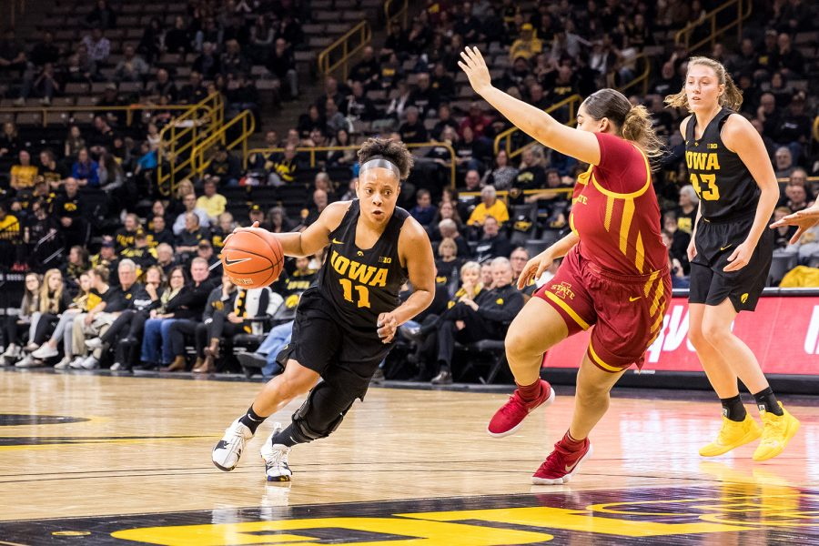 Iowa+guard+Tania+Davis+%2311+dribbles+into+the+lane+during+a+women%27s+basketball+game+against+Iowa+State+University+at+Carver-Hawkeye+Arena+on+Wednesday%2C+Dec.+5%2C+2018.+The+Hawkeyes+defeated+the+Cyclones+73-70.