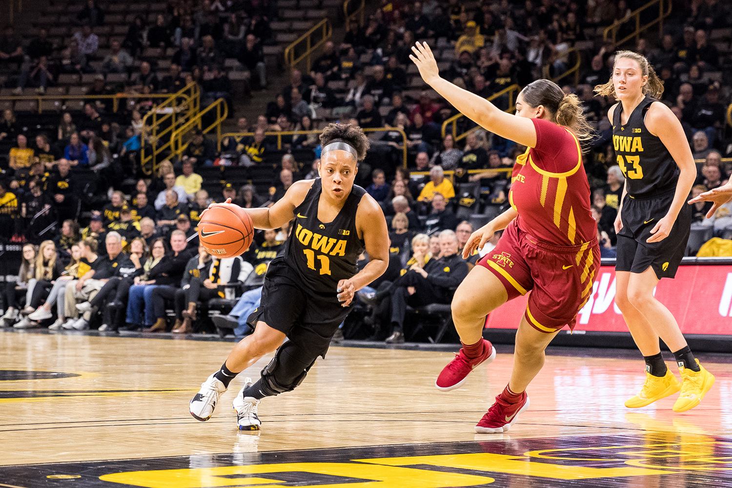 Iowa guard Tania Davis #11 dribbles into the lane during a women's basketball game against Iowa State University at Carver-Hawkeye Arena on Wednesday, Dec. 5, 2018. The Hawkeyes defeated the Cyclones 73-70.