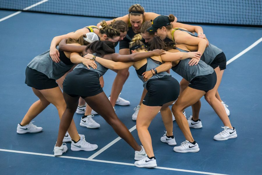 Iowa+players+huddle+before+doubles+play+during+a+women%27s+tennis+match+between+Iowa+and+Maryland+at+the+HTRC+on+Sunday%2C+April+7%2C+2019.+The+Hawkeyes+defeated+the+Terrapins%2C+6-1.