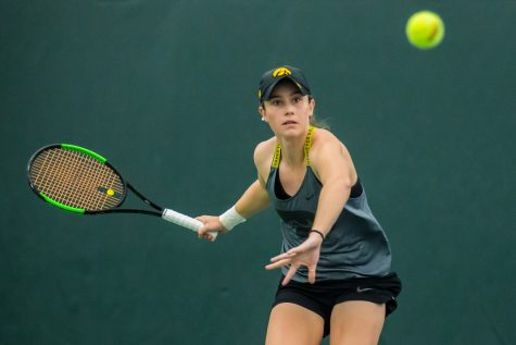 Iowa's Elise Van Heuvelen Treadwell hits a forehand during a women's tennis match between Iowa and Maryland at the HTRC on Sunday, April 7, 2019. The Hawkeyes defeated the Terrapins, 6-1.
