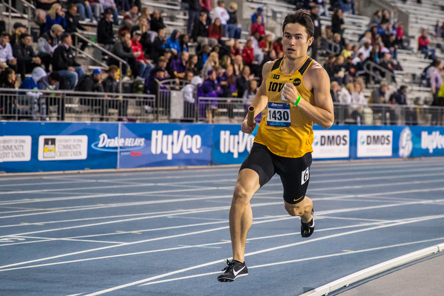 Iowa's Carter Lilly rounds the track during the men's 4x800m race at the 2019 Drake Relays in Des Moines, IA, on Friday, April 26, 2019.