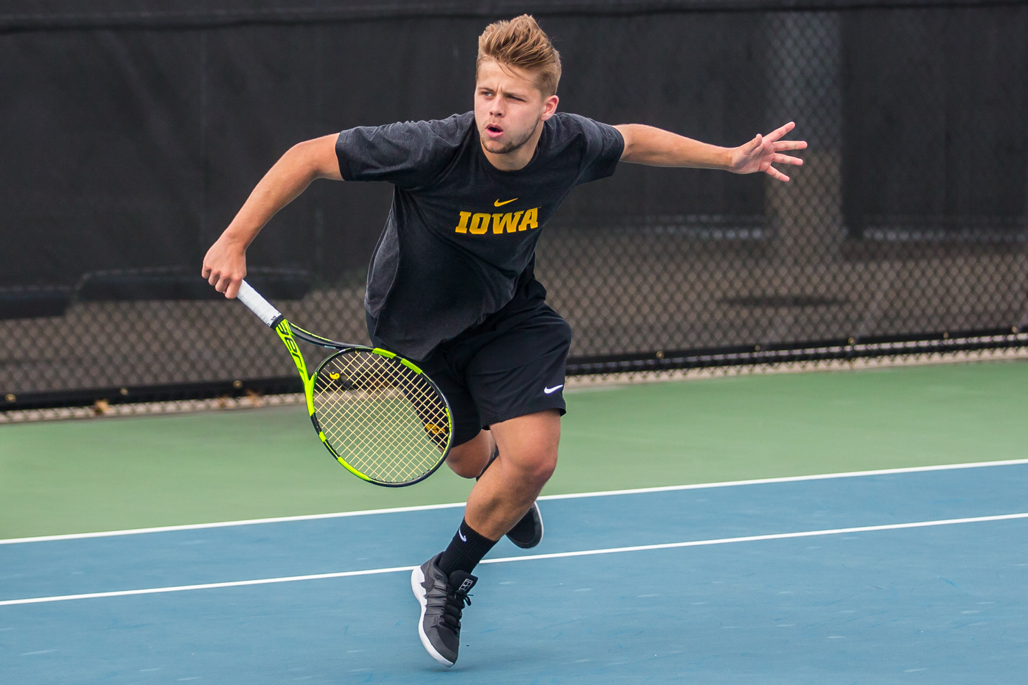 Iowa%27s+Will+Davies+hits+a+backhand+during+a+men%27s+tennis+match+between+Iowa+and+Ohio+State+at+the+HTRC+on+Sunday%2C+April+7%2C+2019.+The+Buckeyes+defeated+the+Hawkeyes%2C+4-1.