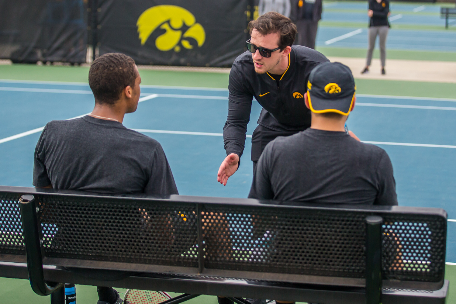Iowa+assistant+coach+Joey+Manilla+talks+to+the+1-doubles+team+during+a+men%27s+tennis+match+between+Iowa+and+Ohio+State+at+the+HTRC+on+Sunday%2C+April+7%2C+2019.+The+Buckeyes+defeated+the+Hawkeyes%2C+4-1.