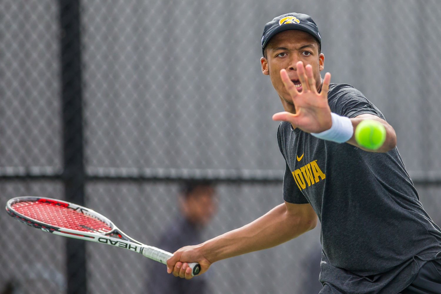 Iowa's Oliver Okonkwo hits a forehand during a men's tennis match between Iowa and Ohio State at the HTRC on Sunday, April 7, 2019. The Buckeyes defeated the Hawkeyes, 4-1.