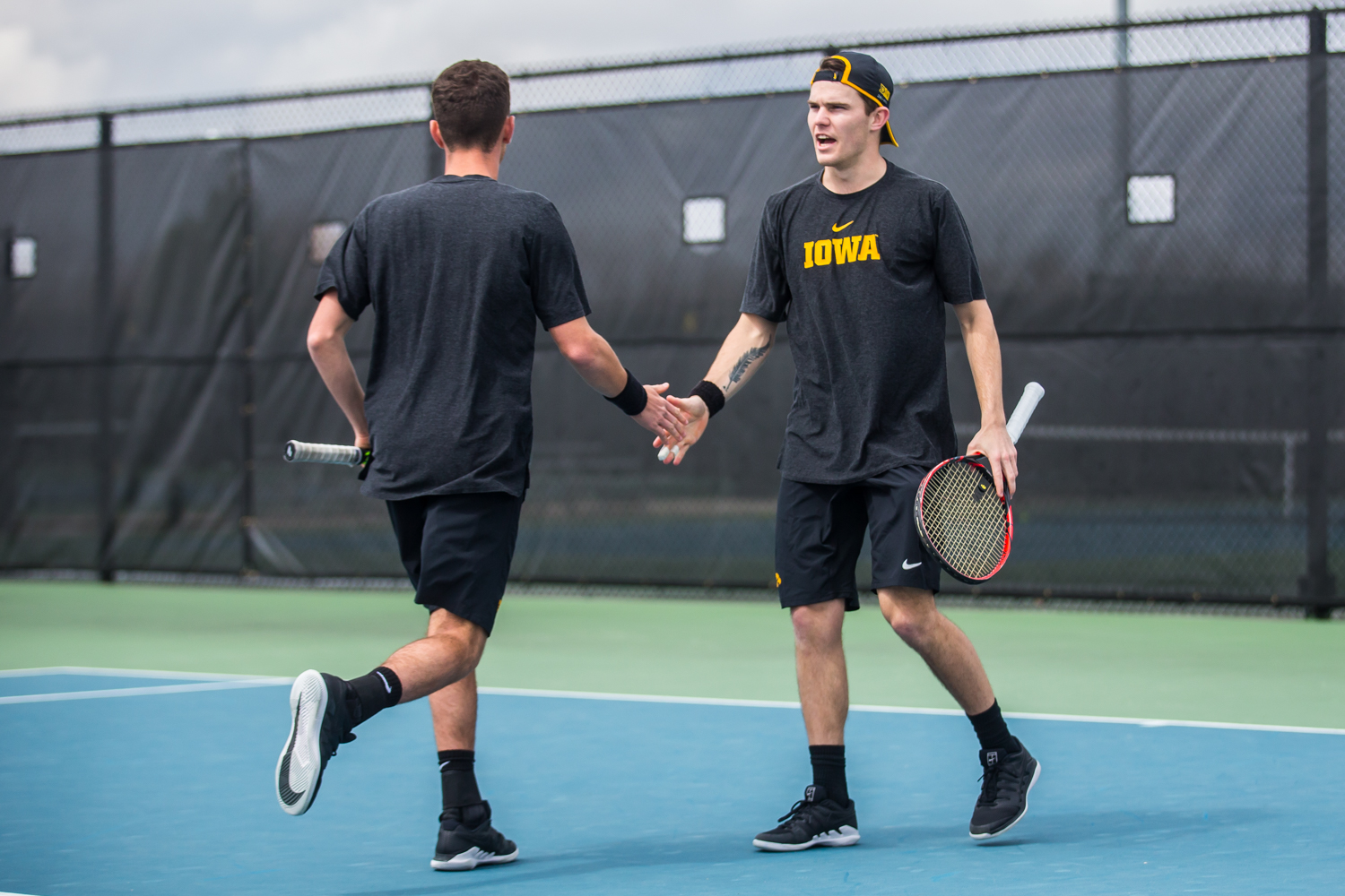 Iowa%27s+Jonas+Larsen+%28right%29+high-fives+Kareem+Allaf+during+a+men%27s+tennis+match+between+Iowa+and+Ohio+State+at+the+HTRC+on+Sunday%2C+April+7%2C+2019.+The+Buckeyes+defeated+the+Hawkeyes%2C+4-1.