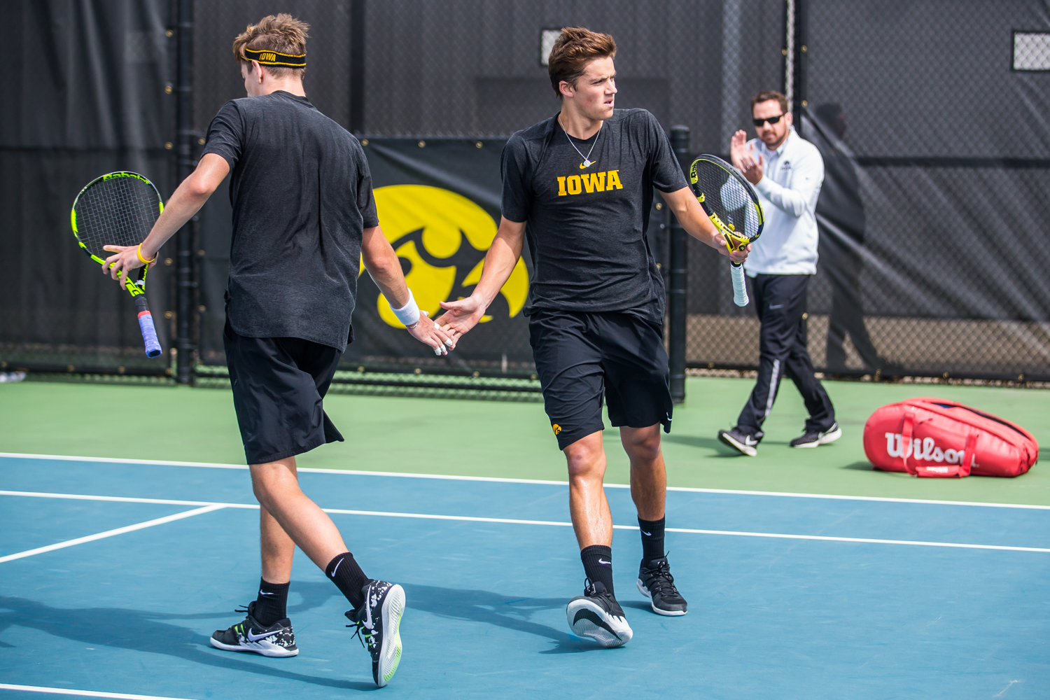 Iowa%27s+Joe+Tyler+high-fives+Nikita+Snezhko+during+a+men%27s+tennis+match+between+Iowa+and+Ohio+State+at+the+HTRC+on+Sunday%2C+April+7%2C+2019.+The+Buckeyes+defeated+the+Hawkeyes%2C+4-1.