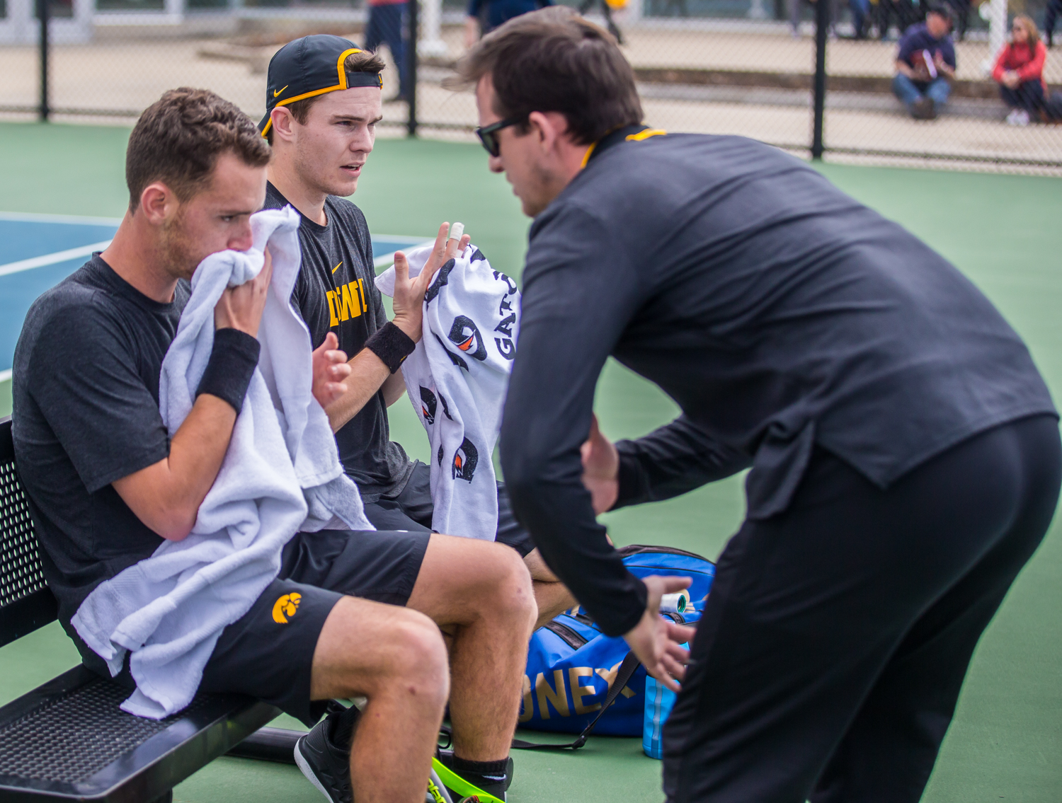 Iowa+assistant+coach+Joey+Manilla+talks+to+the+2-doubles+team+during+a+men%27s+tennis+match+between+Iowa+and+Ohio+State+at+the+HTRC+on+Sunday%2C+April+7%2C+2019.+The+Buckeyes+defeated+the+Hawkeyes%2C+4-1.
