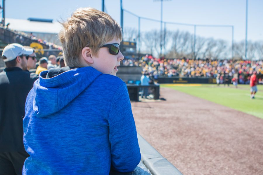 A+young+fan+watches+from+the+first+baseline+during+a+baseball+game+between+Iowa+and+Nebraska+at+Duane+Banks+Field+on+Saturday%2C+April+20%2C+2019.+The+Hawkeyes+defeated+the+Cornhuskers%2C+17-9.