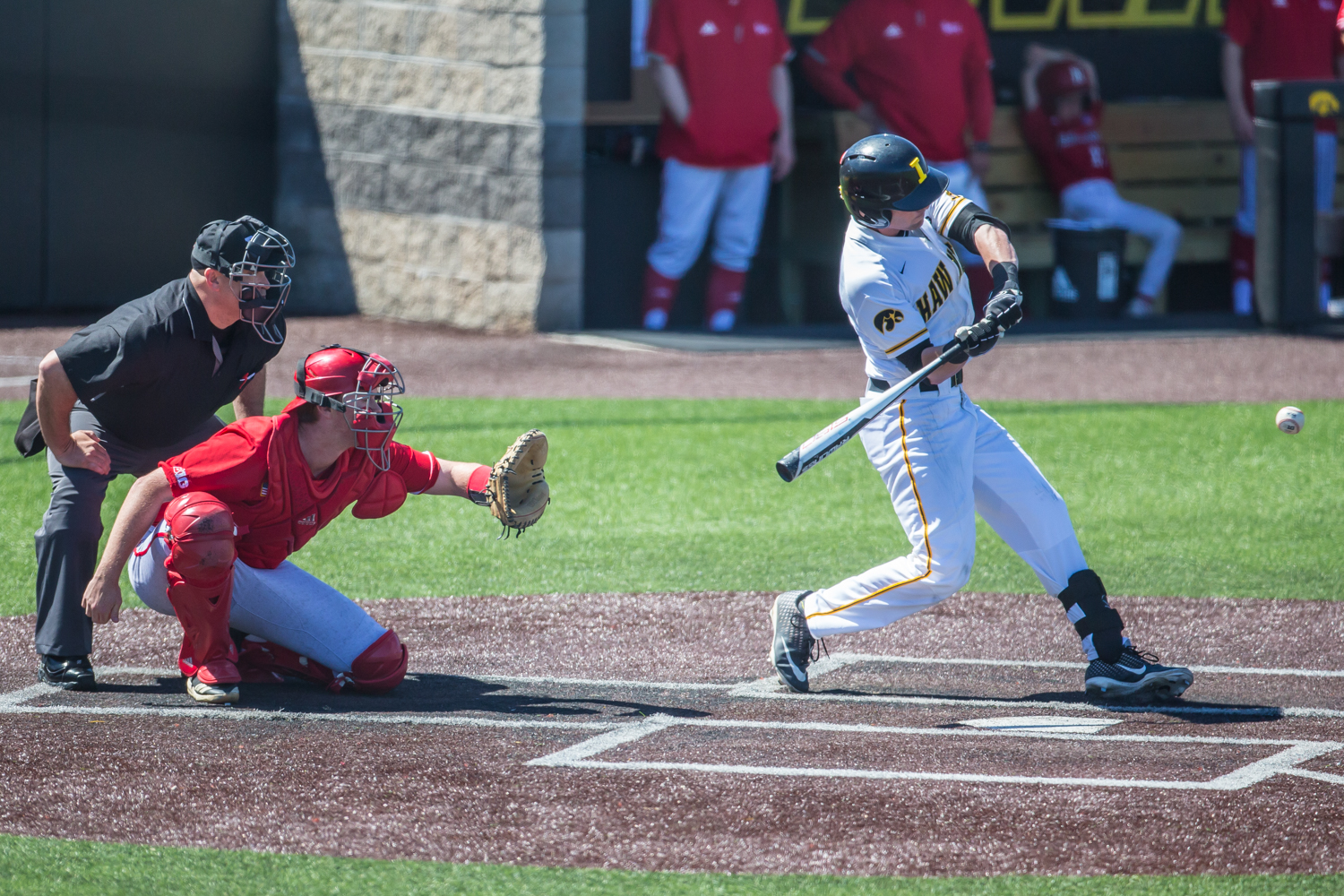 Iowa infielder Chris Whelan swings while at-bat during a baseball game between Iowa and Nebraska at Duane Banks Field on Saturday, April 20, 2019. The Hawkeyes defeated the Cornhuskers, 17-9.