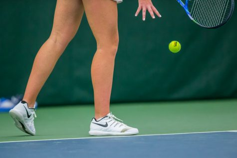 Iowa's Sophie Clark prepares to serve during a women's tennis match between Iowa and Nebraska at the HTRC on Saturday, April 13, 2019. The Hawkeyes, celebrating senior day, fell to the Cornhuskers, 4-2.