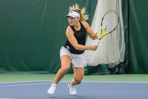 Iowa's Danielle Burich hits a backhand during a women's tennis match between Iowa and Nebraska at the HTRC on Saturday, April 13, 2019. The Hawkeyes, celebrating senior day, fell to the Cornhuskers, 4-2.