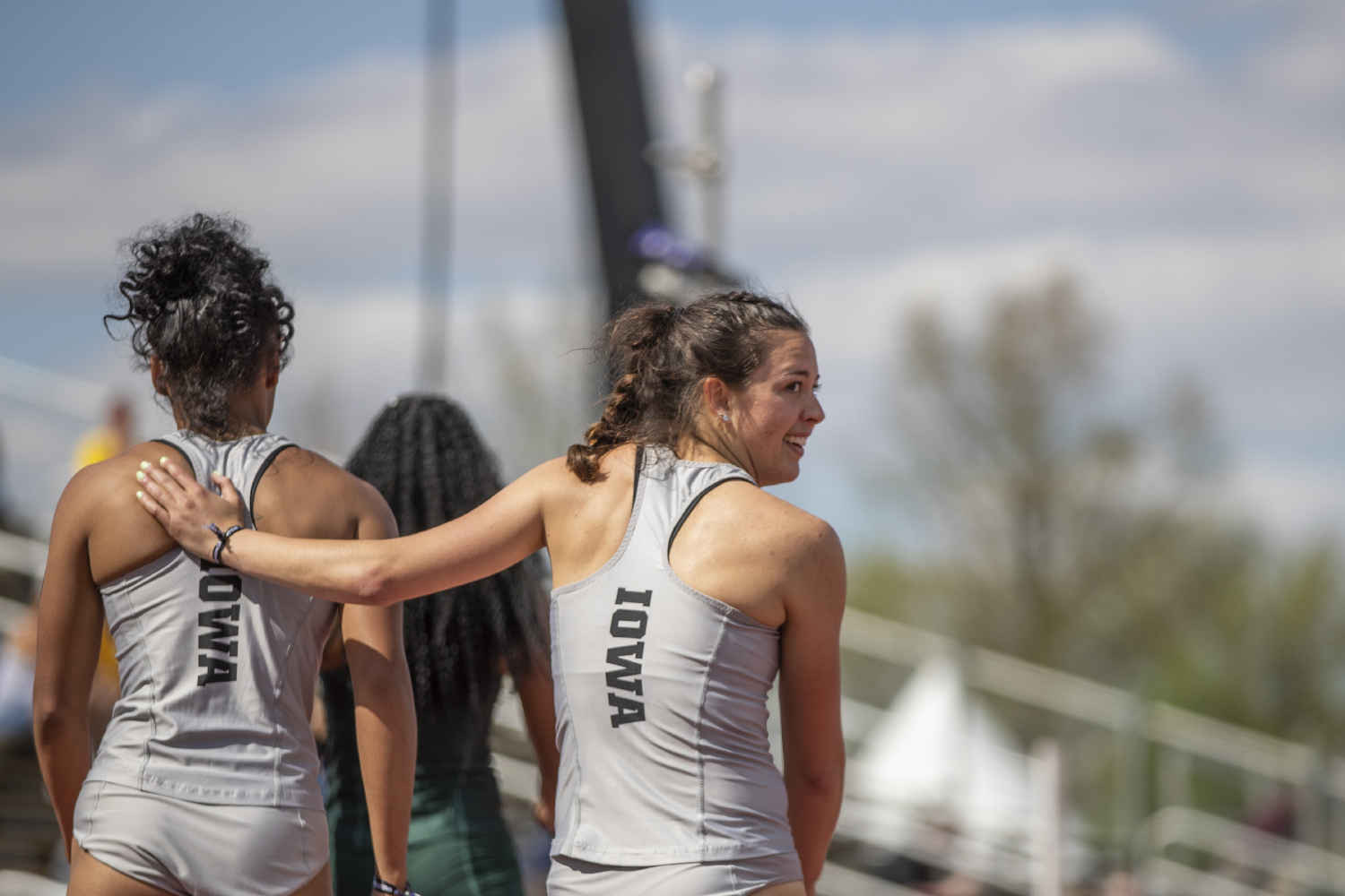 University of Iowa Heptathlete Jenny Kimbro congratulates teammate Tria Simmons after Simmons won their heat of the 200 meter run during the first day of the Big Ten Track and Field Outdoor Championships at Cretzmeyer Track on Friday, May 10, 2019. Simmons won the 200 meter run portion of the heptathlon with a time of 24.19 seconds.