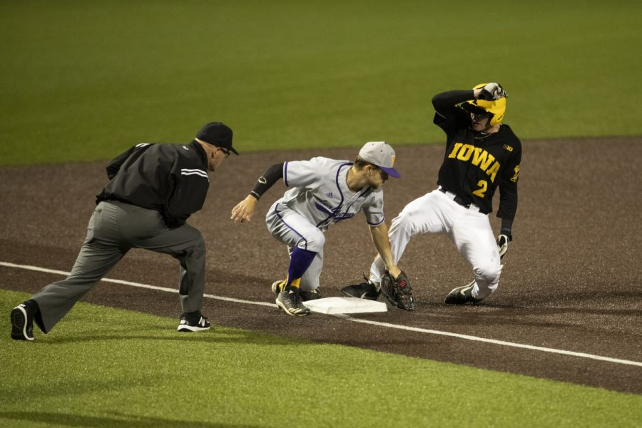 Iowa outfielder Brendan Sher slides in safe to third at a baseball game between the Hawkeyes and Western Illinois at Duane Banks Field, on Wednesday, on May 1, 2019. The Hawkeyes beat the Leathernecks 8-7.