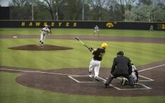 Iowa infielder Chris Whelan hits the ball at a baseball game against Northwestern Illinois at Duane Banks Field on May 1, 2019.