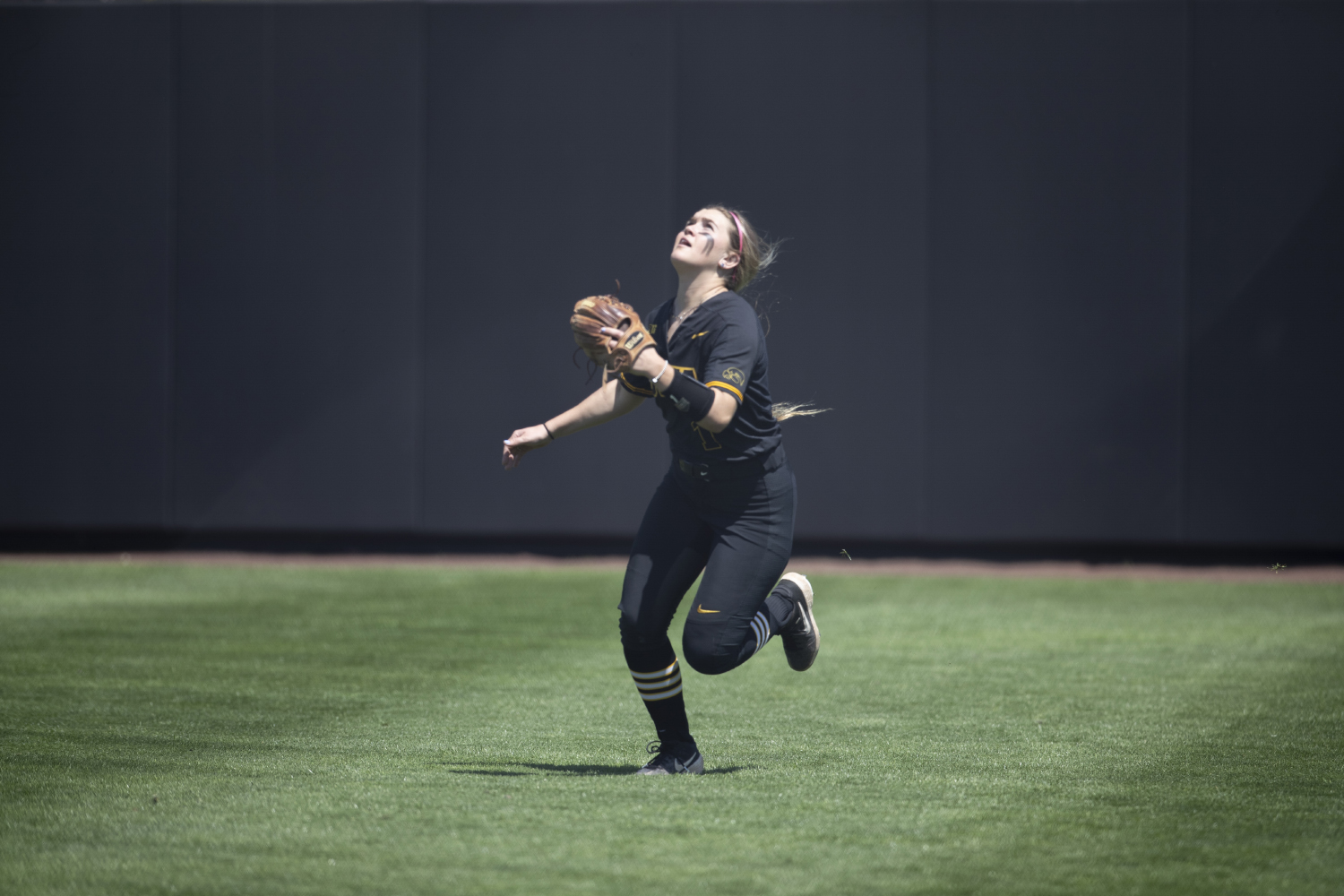 Iowa infielder Cameron Cecil runs before catching the ball during the game against Ohio State at the Bob Pearl Softball field on Saturday, May 4, 2019. The Hawkeyes were defeated by the Buckeyes 0-10.