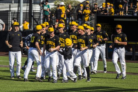 147a30e76 Iowa players celebrate the win against Cal-Irvine at Banks Field on May 4.  The Hawkeyes defeated the Anteaters