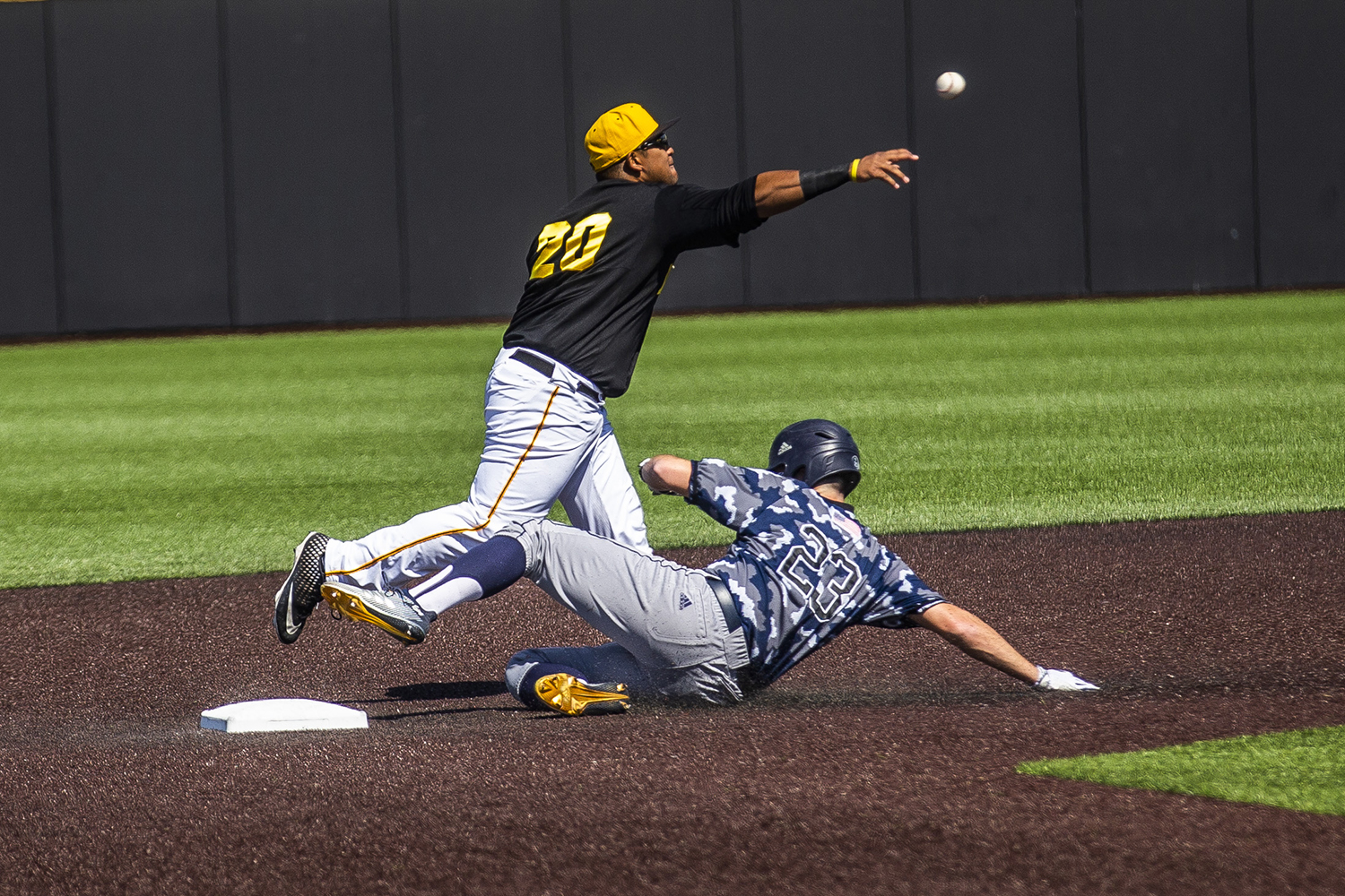 Iowa infielder Izaya Fullard throws the ball to first as UC Irvine infielder Brandon Lewis slides into the base during the game against UC Irvine at Duane Banks Field on Saturday, May 4, 2019. The Hawkeyes defeated the Anteaters 1-0.