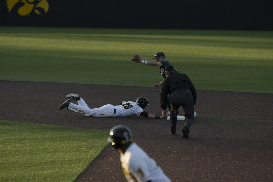 Iowa+infielder+Chris+Whelan+slides+back+to+second+base+and+is+declared+safe+during+the+game+against+Michigan+State+at+the+Duane+Banks+Baseball+Stadium+on+Friday%2C+May+10%2C+2019.+The+Hawkeyes+defeated+the+Spartans+7-5.