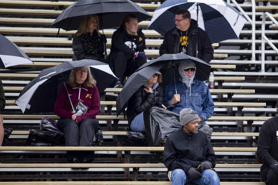 Spectators+sit+in+the+rain+during+the+second+day+of+the+Big+Ten+Track+and+Field+Outdoor+Championships+at+Cretzmeyer+Track+on+Saturday%2C+May+11%2C+2019.+
