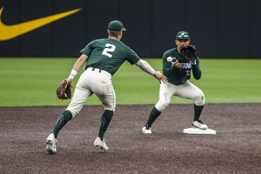 Michigan+State+infielder+Marty+Bechina+throws+the+ball+to+infielder+Royce+Ando+during+the+baseball+game+against+Michigan+State+at+Duane+Banks+Field+on+Saturday%2C+May+11%2C+2019.+The+Spartans+defeated+the+Hawkeyes+9-4.