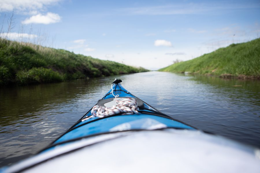 The+front+of+the+kayak+is+seen+in+the+beginning+of+the+Iowa+River%E2%80%99s+west+branch+on+May+20%2C+2019.+The+20-day+expedition+of+the+329-mile+Iowa+River+is+intended+to+provide+insight+into+issues+of+water+quality+within+the+state.+Along+the+way%2C+DI+photojournalist+Ryan+Adams+will+conduct+nitrate+tests+of+the+water+and+speak+with+local+farmers%2C+Iowa+citizens%2C+and+those+along+the+riverbanks+to+understand+how+Iowans+view+the+issue.++