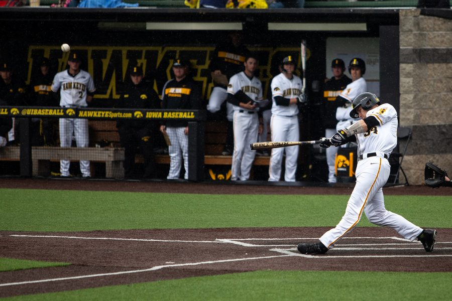 Iowa catcher Austin Martin hits the ball during the baseball game against the Spartans at Duane Banks Field on May 12, 2019. The Hawkeyes were defeated by the Spartans 5-7.