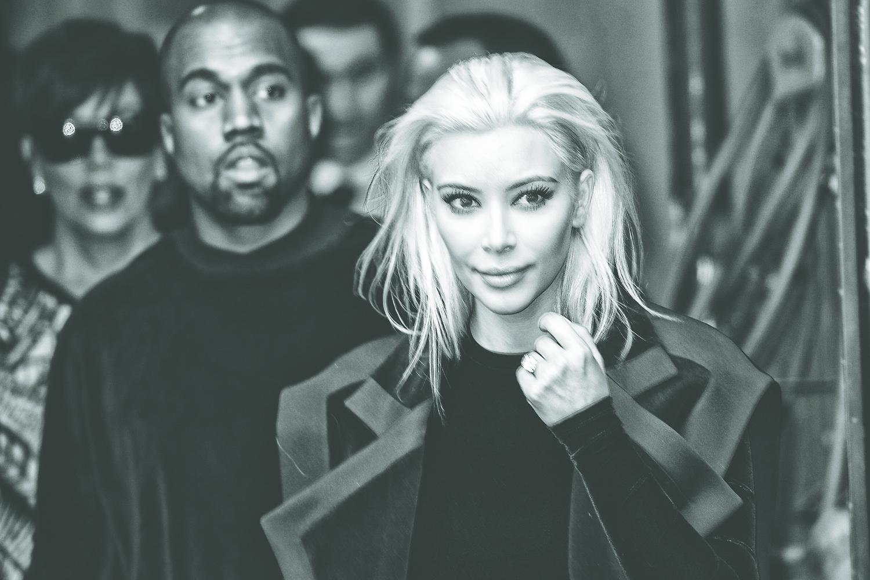 Kanye West and Kim Kardashian arrive at Balmain Fashion Show during Paris Fashion Week on March 5, 2015 in Paris, France.