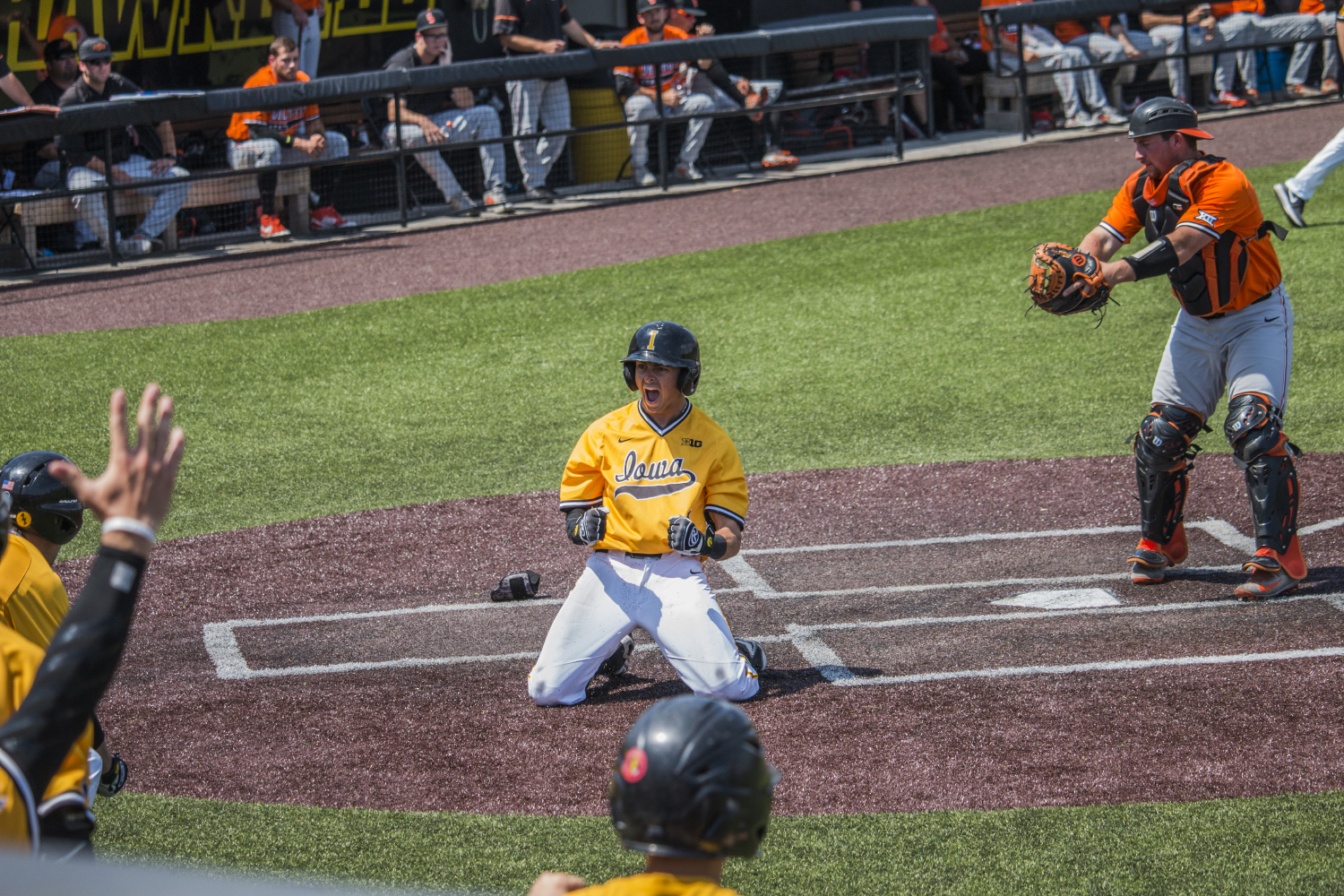Iowa infielder Mitchell Boe celebrates after hitting a home run during baseball Iowa vs. Oklahoma State at Duane Banks Field on May 6, 2018.