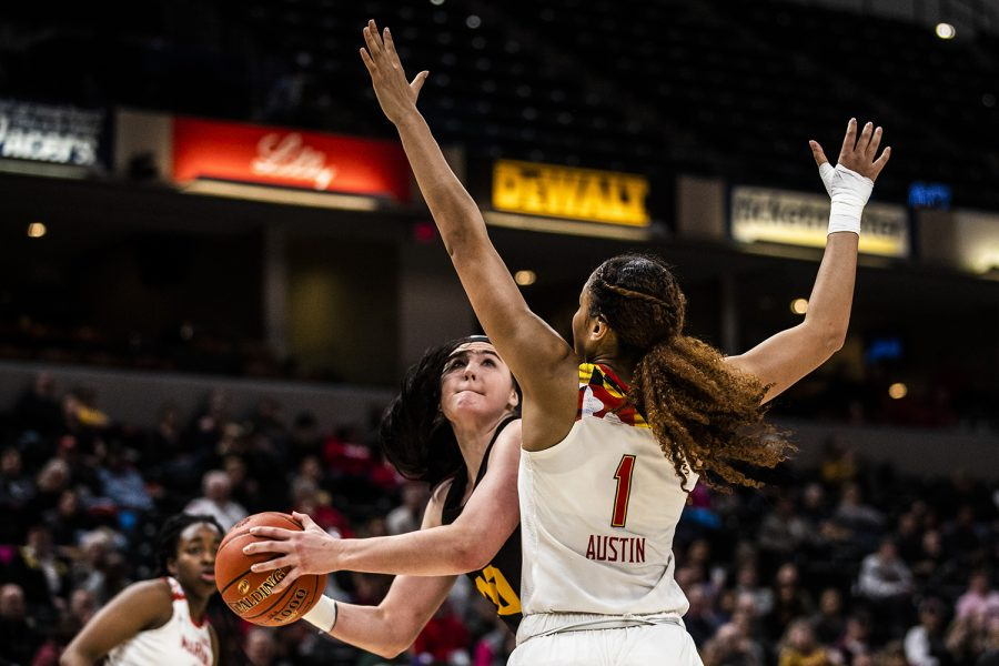 Iowa center Megan Gustafson prepares to shoot the ball past Maryland forward Shakira Austin during the women's Big Ten Championship basketball game vs. Maryland at Bankers Life Fieldhouse on Sunday, March 10, 2019.