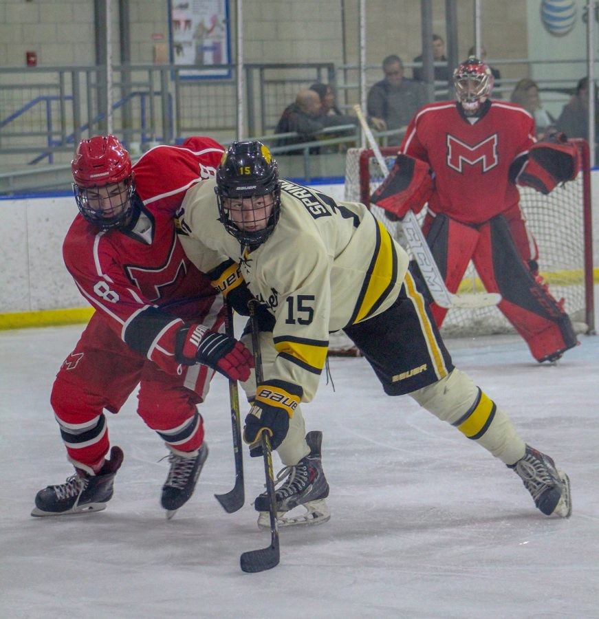Nathan Springberg prepares for puck drop during the game against Maryville on November 30, 2018. (Megan Conroy/The Daily Iowan)