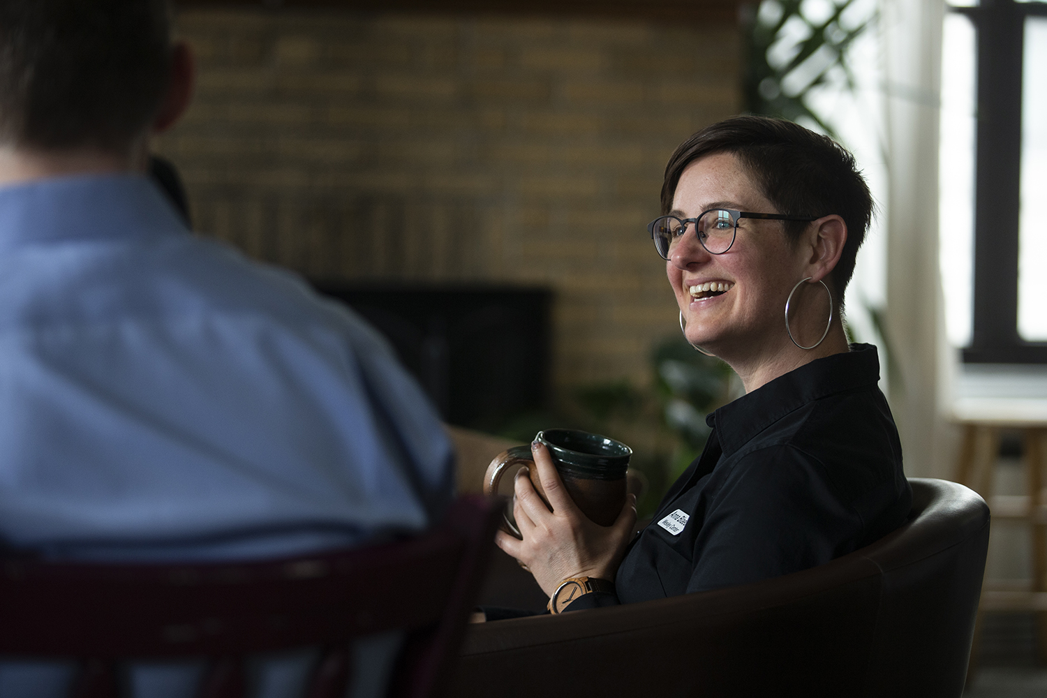 Rev. Anna Blaedel listens during a Bible study at the Wesley Center on May 1, 2019. Openly queer, Blaedel has faced formal complaints by the United Methodist Church.